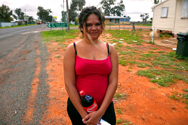 Tara Kelly, from a local Aboriginal community, stands near a remote voting station after she voted in the western New South Wales outback town of Enngonia, Australia, June 22, 2016. (Photo by David Gray/Reuters)