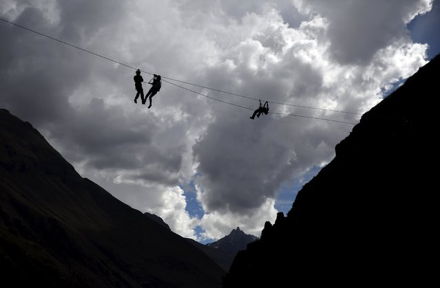 Guests ride a zipline as they leave the Skylodge Adventure Suites in the Sacred Valley in Cuzco, Peru, August 14, 2015. (Photo by Pilar Olivares/Reuters)