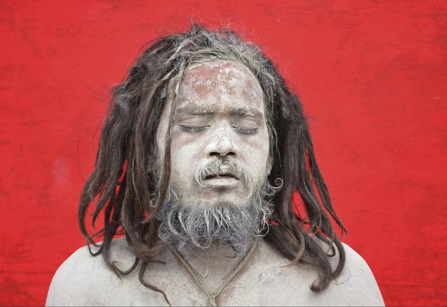 A Sadhu or a Hindu holylam, with his face covered with ash, prays before registering for the annual pilgrimage to the Amarnath cave shrine, at a base camp in Jammu, June 30, 2016. (Photo by Mukesh Gupta/Reuters)