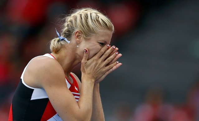 Linda Zublin of Switzerland reacts after competing in the high jump event of women's heptathlon during the European Athletics Championships at the Letzigrund Stadium in Zurich August 14, 2014. (Photo by Phil Noble/Reuters)