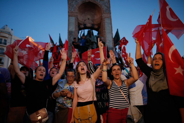People chant slogans as they gather at a pro-government rally in central Istanbul's Taksim square, Saturday, July 16, 2016. (Photo by Emrah Gurel/AP Photo)