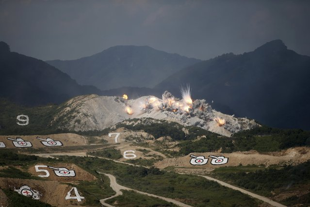 Explosions are seen at a target during a U.S.-South Korea joint live-fire military exercise at a training field near the demilitarized zone separating the two Koreas in Pocheon, South Korea, August 28, 2015. (Photo by Kim Hong-Ji/Reuters)
