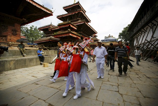 Boys depicting holy cows participate in a parade to mark the Gaijatra Festival, also known as the festival of cows, in Kathmandu, Nepal August 30, 2015. (Photo by Navesh Chitrakar/Reuters)