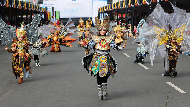 """Models wear Borobudur costumes in the kids carnival during The 13th Jember Fashion Carnival 2014 on August 21, 2014 in Jember, Indonesia. The 13th Jember Fashion Carnival (JFC) 2014 theme is """"Triangle, Dynamic in Harmony"""" and consists of ten parades which include Mahabharata, Tambora, Phoenix, Pine Forest, Apache, Borobudur, Flying Kite, Wild Deers, Stalagmite, and Chemistry. (Photo by Robertus Pudyanto/Getty Images)"""