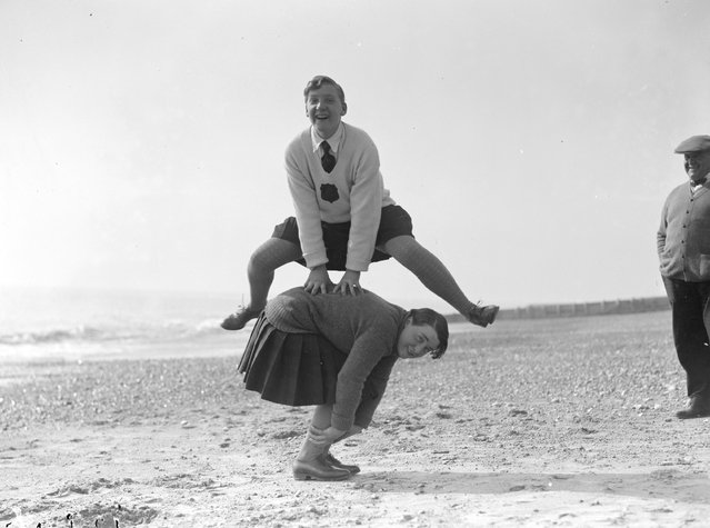 A couple of young women playing leap frog on the beach at Hove, March 1929.