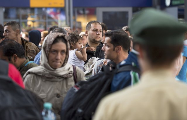Migrants arrive to the main railway station in Munich, Germany, September 1, 2015. The German government expects that between 240,000 and 460,000 extra people will be entitled to social benefits next year due to the influx of refugees and migrants, Labour Minister Andrea Nahles said on Tuesday. (Photo by Lukas Barth/Reuters)