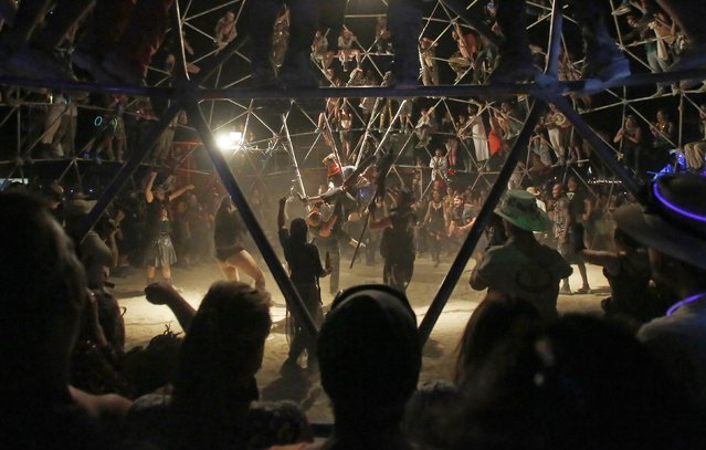 "A crowd watches as two fighters battle in the Thunderdome during the Burning Man 2014 ""Caravansary"" arts and music festival in the Black Rock Desert of Nevada, August 27, 2014. (Photo by Jim Urquhart/Reuters)"