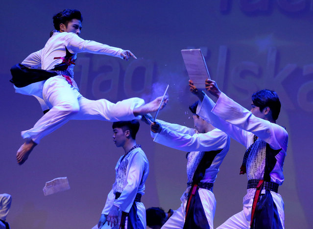 Members of the South Korean taekwondo team perform during the commemoration ceremony for the 63th anniversary of the Korea War Armistice Agreement and UN Forces Participation Day in Seoul, South Korea, 27 July 2016. The event was organized to mark the 63th anniversary of the signing of the armistice that ended the Korean War, which falls on 27 July. (Photo by Jeon Heon-Kyun/EPA)