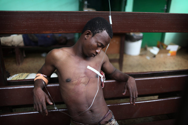 Central African Republic by Pierre Terdjman – The Seleka militia took over in March 2013, and perpetrated massive violations of human rights – massacres, rape, torture and executions, and burning villages to the ground. (Photo by Pierre Terdjman/Paris Match)