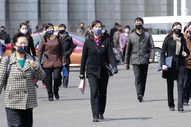 In this April 1, 2020, file photo, pedestrians wear face masks to help prevent the spread of the new coronavirus in Pyongyang, North Korea. North Korea says it has zero coronavirus infections, but experts doubt it and say it's likely the virus has already spread in the country. (Photo by Cha Song Ho/AP Photo/File)