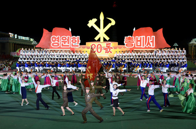 North Koreans celebrate the 20th anniversary of former North Korean leader Kim Jong Il's appointment as the General Secretary of the Workers' Party of Korea in Pyongyang October 8, 2017 in this photo released by North Korea's Korean Central News Agency (KCNA) on October 9, 2017. (Photo by Reuters/KCNA)