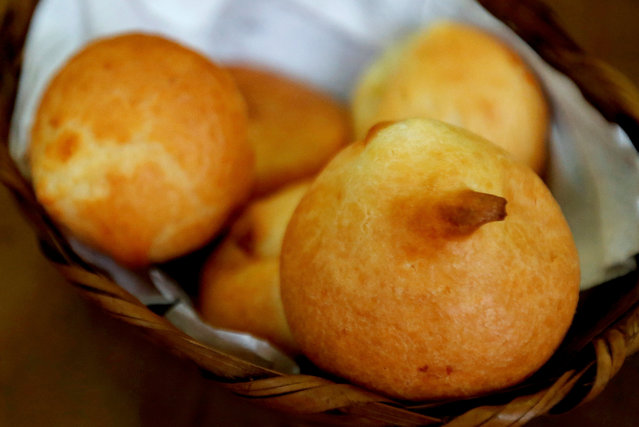 Paes de queijo (cheese bread) lies in a basket at the Cultivar cafe and store at Santa Teresa neighbourhood in Rio de Janeiro, Brazil, July 28, 2016. (Photo by Sergio Moraes/Reuters)