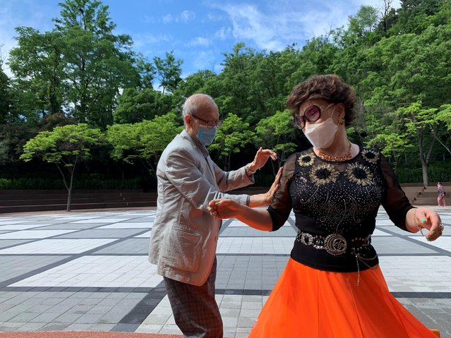 "South Korean residents 89-year-old Jeong Nam-poong and 80-year-old Jang Yoon-hui , wearing protective masks, dance at park after their daytime discotheque ""colatec"" has been closed amid the coronavirus disease (COVID-19) outbreak in Seoul, South Korea, May 19, 2020. (Photo by Minwoo Park/Reuters)"