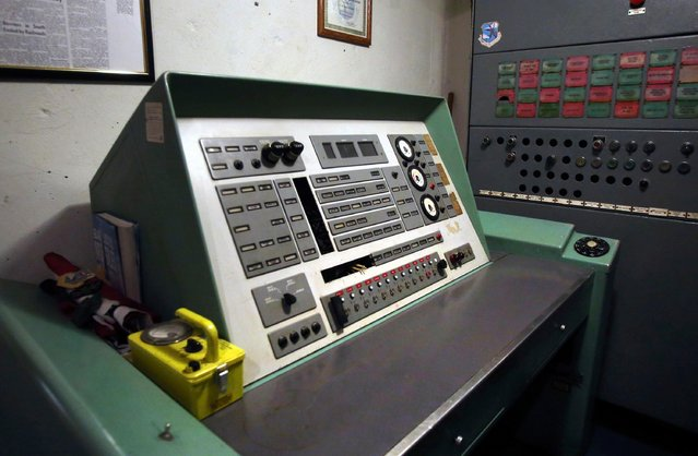"""This November 2, 2017 photo shows the launch control panel for the Atlas missile at a silo missile base that has been converted into the Subterra Airbnb near Eskridge, Kan. It was designed to house a nuclear warhead six decades ago – but now, this Cold War silo is the perfect spot for a mini break at just $133 a night. The underground mansion has been marketed as a """"truly unique experience"""", with the former Atlas E missile base transformed into a luxury Airbnb listing. The 33 acre property is just 15 miles southwest of Topeka, Kansas, with the house itself completely underground. The space is decorated in bohemian eclectic style for its guests, who can make the most of the hot tub and have tours around the quirky space, even checking out the launchpad control. Ed and Dianna Peden own the silo and have lived there since 1994, listing it as the perfect place for a history buff, or anyone wanting a unique place to stay the night. They said: """"The underground missile site has a fascinating Cold War history for you to discover. Guests will also be inspired by the story of its transformation from a bunker into a home"""". The impressive space is about 18,000 square feet, while the outside area offers an outdoor pond, and moon deck. Visitors will also be able to make the most of wildlife, and can expect to see the occasional mountain lion, coyotes, deer and skunks. It is believed to be the first and only Airbnb located in a converted missile silo. (Photo by Thad Allton/The Topeka Capital-Journal via AP Photo)"""