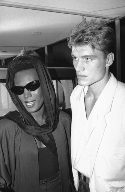 """Entertainer Grace Jones, and her fiance, Hans Armstrong attended the opening of New York's video club """"Private Eyes"""" Tuesday, July 18, 1984. (Photo by Mario Suraini/AP Photo)"""