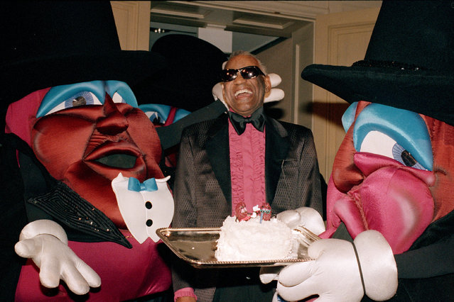 With the help of the life-size dancing raisins, entertainer Ray Charles laughs when presented a cake to celebrate his 58th birthday Friday, September 24, 1988 at the Beverly Hills Hotel. (Photo by Reed Saxon/AP Photo)