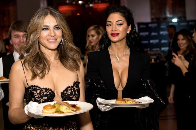 Elizabeth Hurley (L) and Nicole Scherzinger serve dinner at the BOVET 1822 Brilliant is Beautiful Gala benefitting Artists for Peace and Justice's Global Education Fund for Women and Girls at Claridge's Hotel on December 1, 2017 in London, England. (Photo by Vianney Le Caer/Rex Features/Shutterstock)