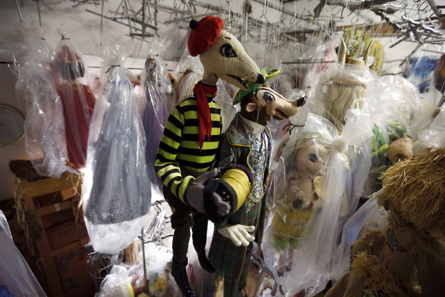 Marionettes hang in a storage area at the Bob Baker Marionette Theater in Los Angeles, California October 17, 2014. (Photo by Lucy Nicholson/Reuters)