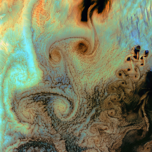 Von Karman Vortices. As air flows over and around objects in its path, spiraling eddies, known as Von Karman vortices, may form. The vortices in this image, taken by Landsat 7 on July 4th, 2002, were created when prevailing winds sweeping east across the northern Pacific Ocean encountered Alaska's Aleutian Islands. (Photo by NASA/GSFC/USGS EROS Data Center)