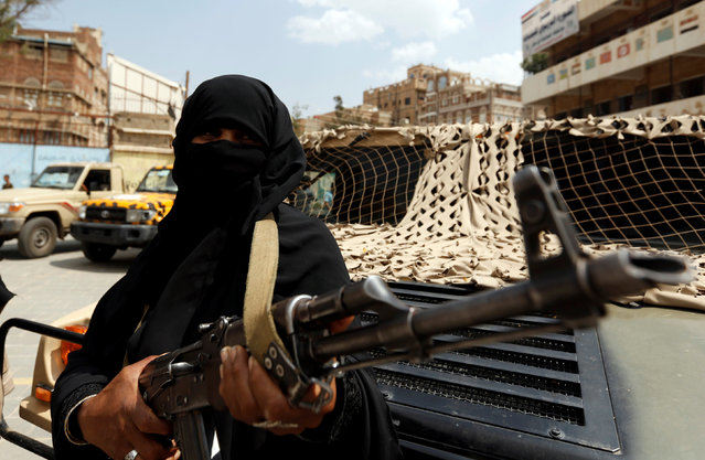 An armed woman loyal to the Houthi movement holds a rifle as she takes part in a parade to show support for the movement in Sanaa, Yemen September 6, 2016. (Photo by Khaled Abdullah/Reuters)