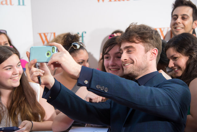 "Actor Daniel Radcliffe poses for a selfie with a fan at the ""What If"" New York Premiere at Regal E-Walk 13 on August 4, 2014 in New York City. (Photo by Mike Pont/FilmMagic)"