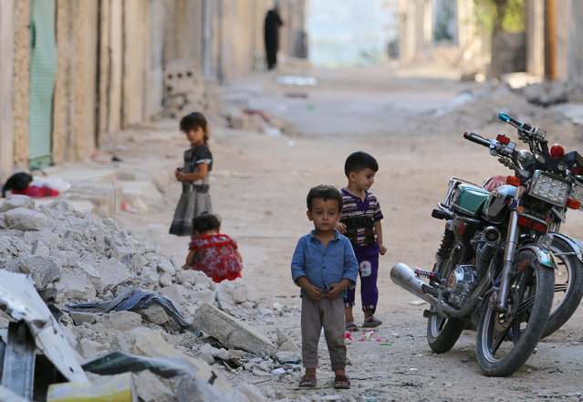 Children play along a street in the rebel-held al-Sheikh Said neighbourhood of Aleppo, Syria September 1, 2016. (Photo by Abdalrhman Ismail/Reuters)