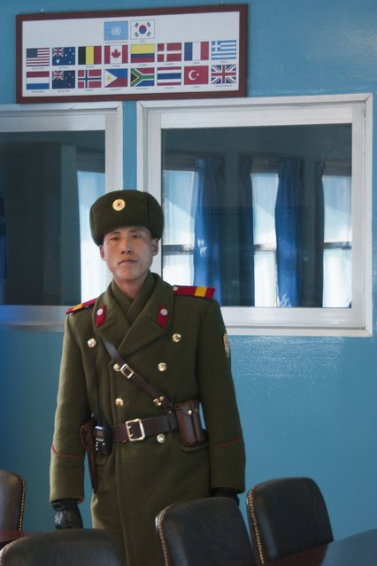 A guard along the border of South Korea in February 2013, in the Demilitarized Zone, North Korea. (Photo by Andrew Macleod/Barcroft Media)