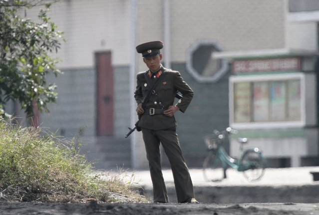An armed North Korean soldier stands guard on the banks of Yalu River, near the North Korean town of Sinuiju, opposite the Chinese border city of Dandong, North Korea, September 9, 2015. (Photo by Jacky Chen/Reuters)