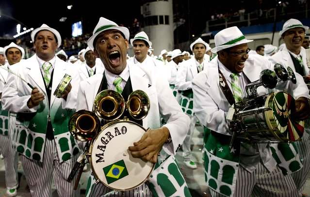 Drummers from the Mancha Verde samba school perform in Sao Paulo. (Photo by Andre Penner/Associated Press)