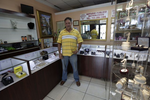 Former Cuban rafter Faustino Jose, 60, poses in his jewellery store in Miami, September 16, 2014. Faustino, who was an industrial engineer in Cuba, said he studied all of Thor Heyerdahl's books about rafting before building his own and leaving Cuba in 1994. (Photo by Rolando Pujol Rodriguez/Reuters)
