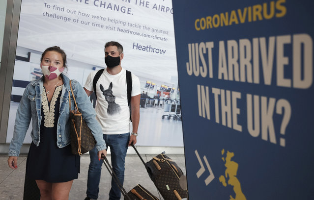 Passengers Charlotte and Frank, arrive at Heathrow Airport as they return from Mykonos in Greece, after the British Government added the island to the coronavirus quarantine list, at Heathrow, London, Tuesday September 8, 2020.  From early Wednesday, people arriving from several Greek islands will need to self-isolate for 14-days, but mainland Greece will maintain its quarantine-exemption, according to Britain's Transport Secretary Grant Shapps, who said that England is to start applying a regional approach to its coronavirus quarantine policy. (Photo by Yui Mok/PA Wire via AP Photo)