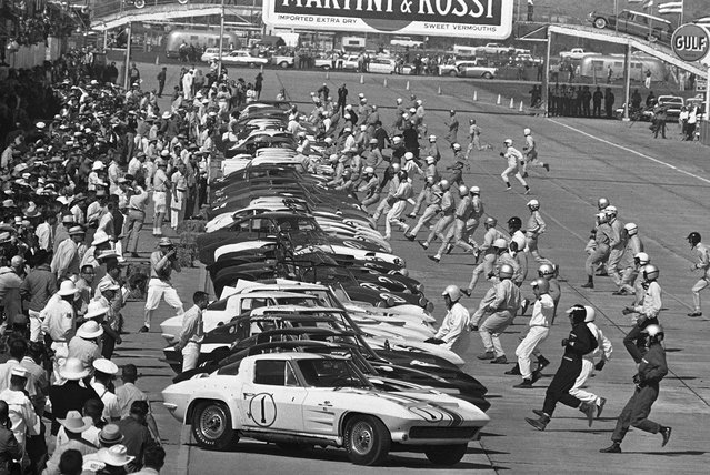 Sixty five drivers run for their cars at start of International 12-hour endurance race at Sebring, Florida, on March 23, 1963. (Photo by James P.Kerlin/AP Photo)