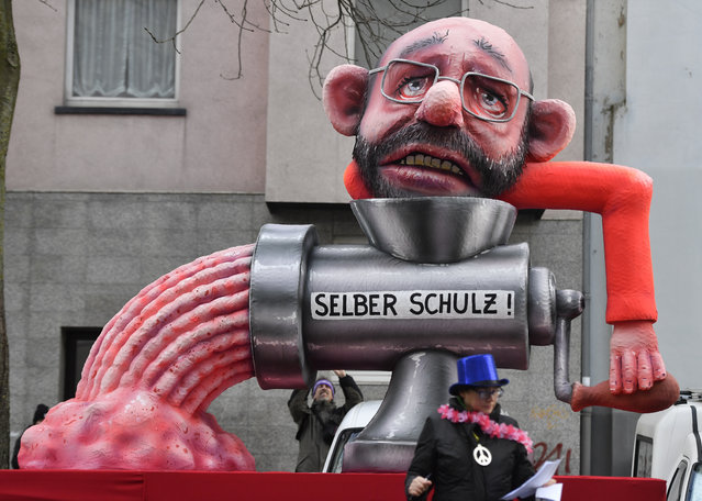 A float depicts Merkel's challenger in last year's election Martin Schulz put himself into a mincer during the traditional Rose Monday parade in Duesseldorf, Germany, Shrove Monday, February 12, 2018. (Photo by Martin Meissner/AP Photo)