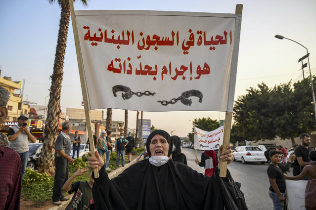 A Lebanese mother of a prisoner in Roumieh prison shouts slogans and carries a placard reads in Arabic 'Life in lebanese prions is a crime by itself' during a protest at the main road leading to Rafik Hariri international airport during a protest in Beirut, Lebanon, 17 September 2020. The families of prisoners are calling for a general amnesty, and for the protection of prisoners following the spread of COVID-19 in the facility, where according to media reports, there is an increasing numbers of COVID-19 cases. (Photo by Wael Hamzeh//EPA/EFE/Rex Features/Shutterstock)