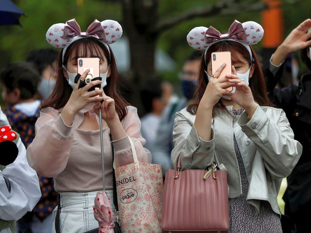 Visitors using smartphones take photos of the new area featuring movie Beauty and the Beast, ahead of the opening to public of the area, amid the coronavirus disease (COVID-19) outbreak, at Tokyo Disneyland in Urayasu, east of Tokyo, Japan, September 25, 2020. (Photo by Issei Kato/Reuters)