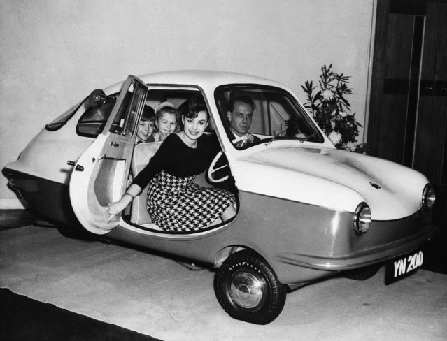 With four persons seated comfortably inside,a new English low priced, three wheel car, a Nobel 200 is put on display in London, February24,1959. The Nobel 200 is produced by Short Brothers and Harland, the body coming from the Bristol Aeroplane Company's works.   The three-wheeler is powered by a single-cylinder, air-cooled engine.   Drive is on the back wheel, ratioed through a four-speed gear-box which can go up to 60 miles an hour. (Photo by AP Photo)