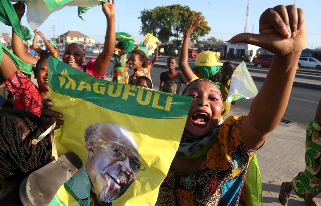 Supporters of Tanzania Presidential candidate of the ruling Chama Cha Mapinduzi (CCM) John Pombe Magufuli celebrate after he was declared the winner of the presidential election, in Dar es Salaam, October 29, 2015. (Photo by Emmanuel Herman/Reuters)