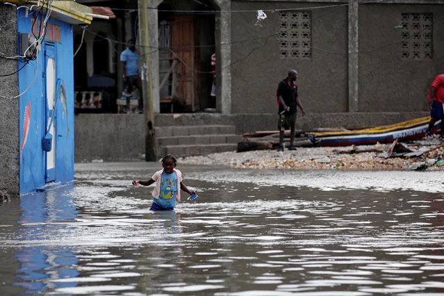 A girl walks in a flooded area after Hurricane Matthew in Les Cayes, Haiti, October 5, 2016. (Photo by Andres Martinez Casares/Reuters)