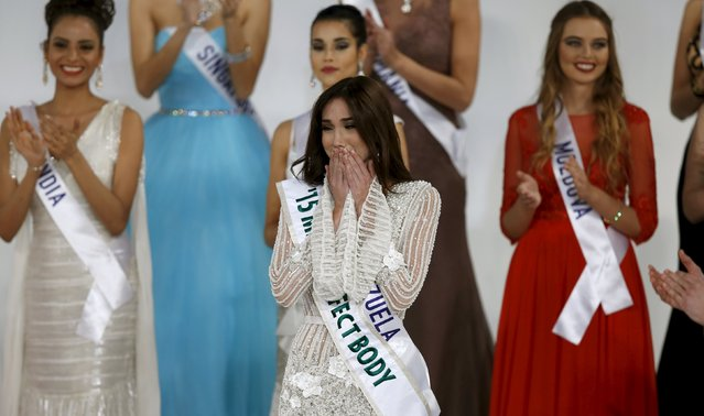 Edymar Martinez representing Venezuela (C) reacts after winning the 55th Miss International Beauty title during the competition in Tokyo, Japan, November 5, 2015. (Photo by Toru Hanai/Reuters)