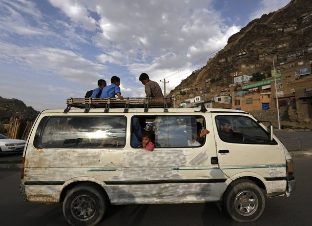 People travel in an overcrowded van in Kabul August 31, 2014. (Photo by Mohammad Ismail/Reuters)