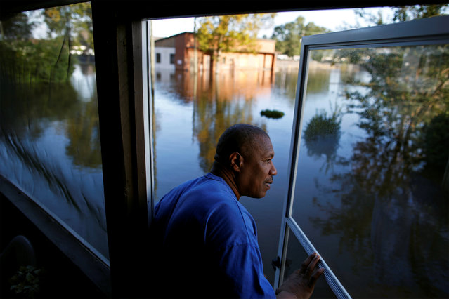 Eric McClary of West Mulberry Lane checks flood levels while checking on his flooded home after the effects of Hurricane Matthew in Goldsboro, North Carolina, U.S., October 12, 2016. (Photo by Randall Hill/Reuters)