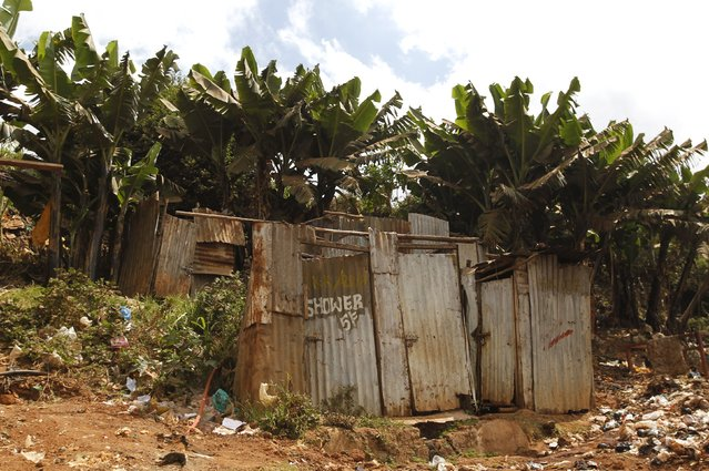 A public toilet made of rusty sheets of metal stands in Gatwekera village in Kibera slum in Nairobi, Kenya, October 12, 2015. (Photo by Thomas Mukoya/Reuters)