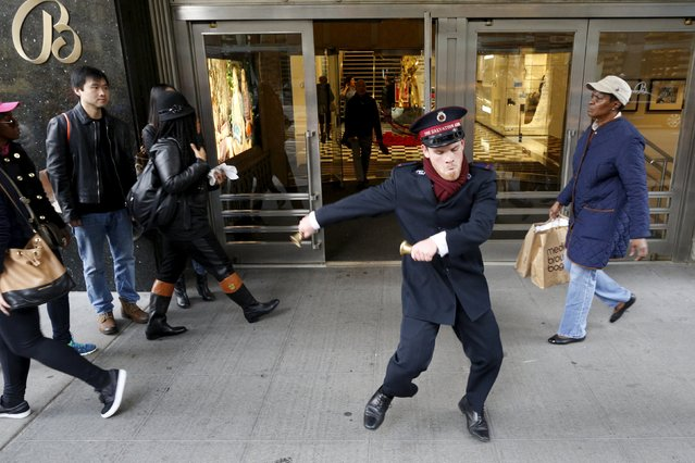 Salvation Army Bell Ringer Nate Hinzman dances for Black Friday shoppers outside Bloomingdales department in the Manhattan borough of New York, November 27, 2015. (Photo by Brendan McDermid/Reuters)