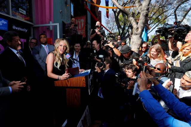 "Stormy Daniels, the p*rn star currently in legal battles with U.S. President Donald Trump, speaks during a ceremony in her honor in West Hollywood, California, U.S., May 23, 2018. Daniels, whose real name is Stephanie Clifford, earned international headlines for her legal battle with President Donald Trump over an alleged affair she claims the pair had a decade ago. West Hollywood Mayor John Duran proclaimed May 23, 2018 ""Stormy Daniels Day"", recognizing Clifford for ""her leadership in the #RESIST movement"". (Photo by Mike Blake/Reuters)"