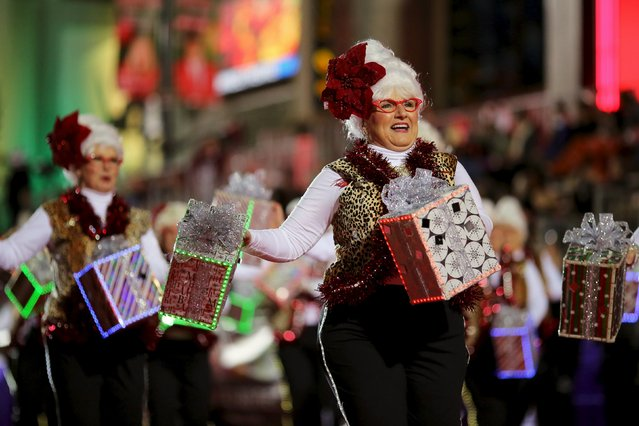 Members of the Blazen Divaz, from Coeur d'Alene, Idaho, march in the 84th Annual Hollywood Christmas Parade in the Hollywood section of Los Angeles, California, November 29, 2015. (Photo by David McNew/Reuters)