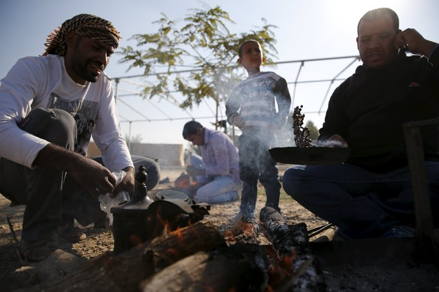 Bedouin men roast coffee beans during preparations to welcome the release of their relative Uda Tarrabin, in the Tarrabin tribe's village near the Bedouin town of Rahat in southern Israel December 10, 2015. (Photo by Amir Cohen/Reuters)