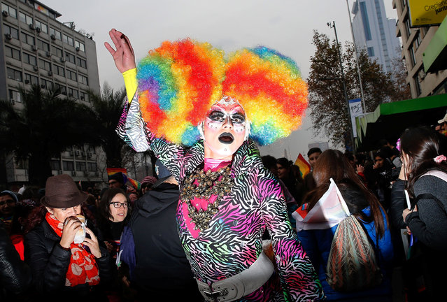 A participant performs during a gay pride parade to demand for a new law for gender equality, according to organizers, in Santiago, Chile June 23, 2018. (Photo by Rodrigo Garrido/Reuters)