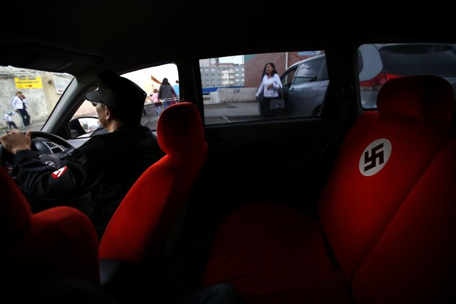 A swastika is seen on the seat of a car belonging to Ariunbold, leader of the Mongolian neo-Nazi group Tsagaan Khass, as he drives along a busy street in Ulan Bator June 22, 2013. (Photo by Carlos Barria/Reuters)