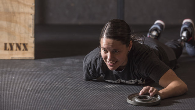In a September 26, 2016 photo, Marine veteran Cindy Martinez stretches ahead of a weightlifting workout at the Crossfit Goat gym in Dacula, Georgia. Martinez lost three limbs and part of the fingers on her remaining arm after getting a flesh-eating bacteria in 2015 and nearly dying. (Photo by Lisa Marie Pane/AP Photo)