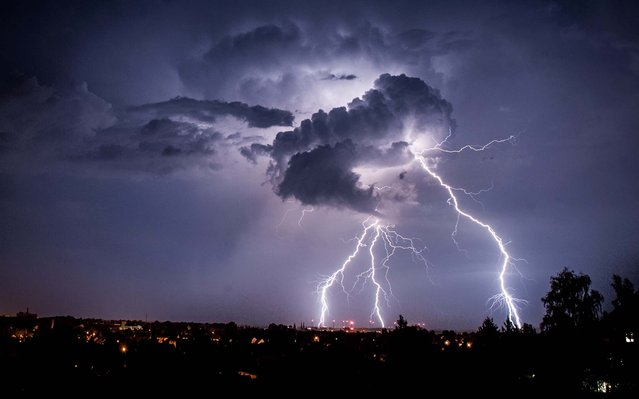 Lightning strikes during a thunderstorm above the city of Goerlitz, Germany, on August 4, 2013. (Photo by Florian Gaertner/DPA)